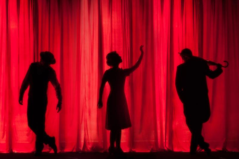 Three performers silhouette